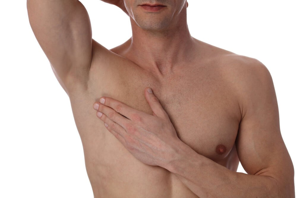 Man Holding Chest Photo